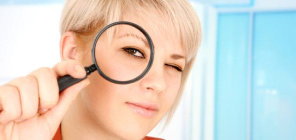 Woman-with-magnifying-glass-720x340