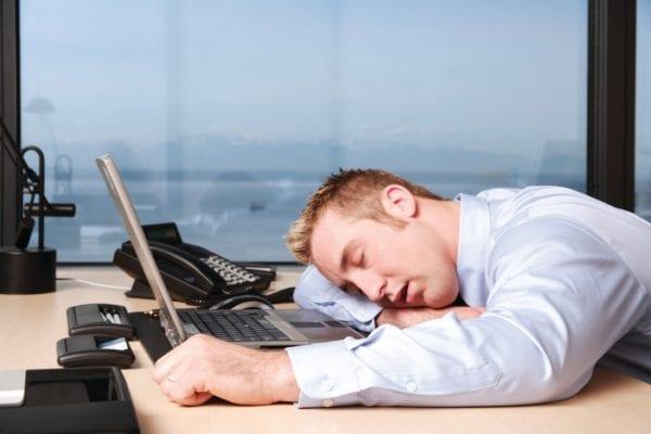 man-asleep-on-desk