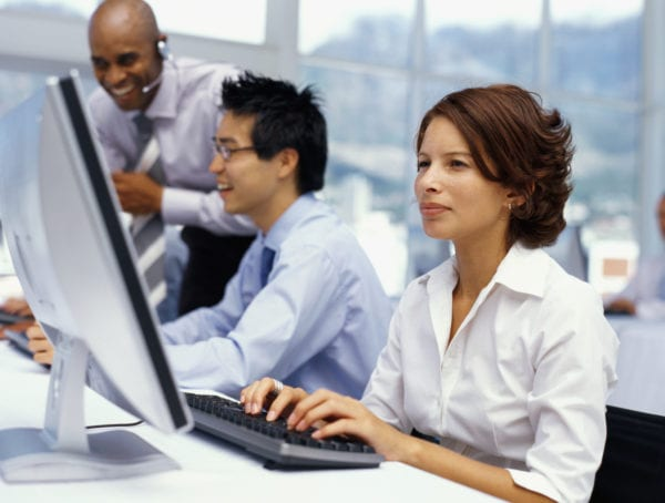 businessman training business executives in a classroom