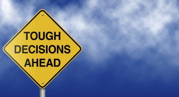 Tough Decisions Ahead Road Sign