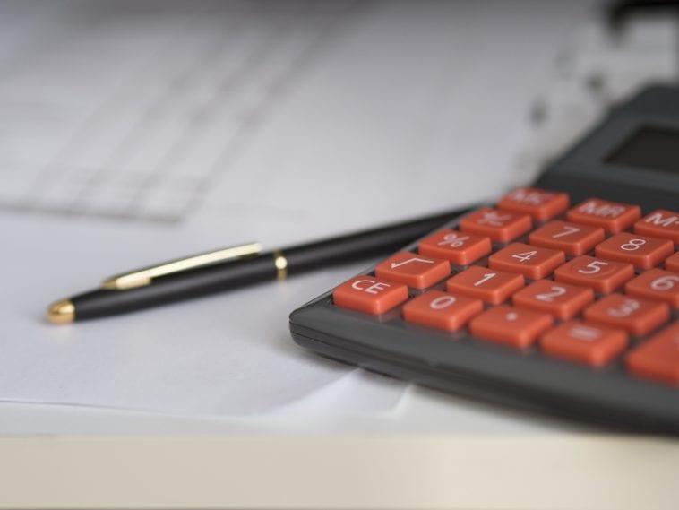 Calculator and pen photo